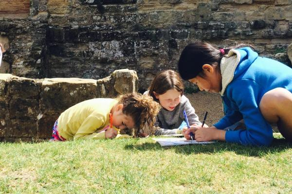 Kids doing history in Oxford Castle